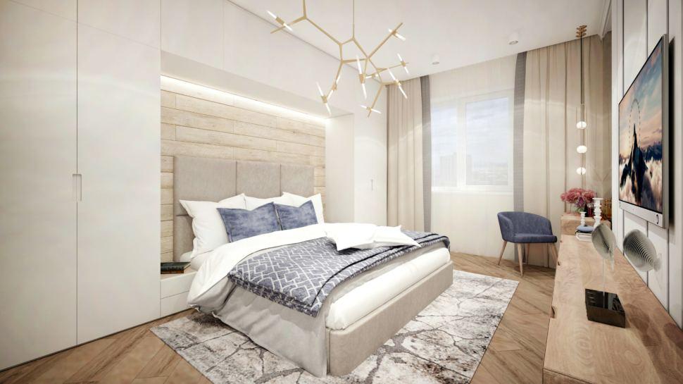 Интерьер спальни в природных тонах с синими акцентами, кровать, золотая люстра, кресло, тумба