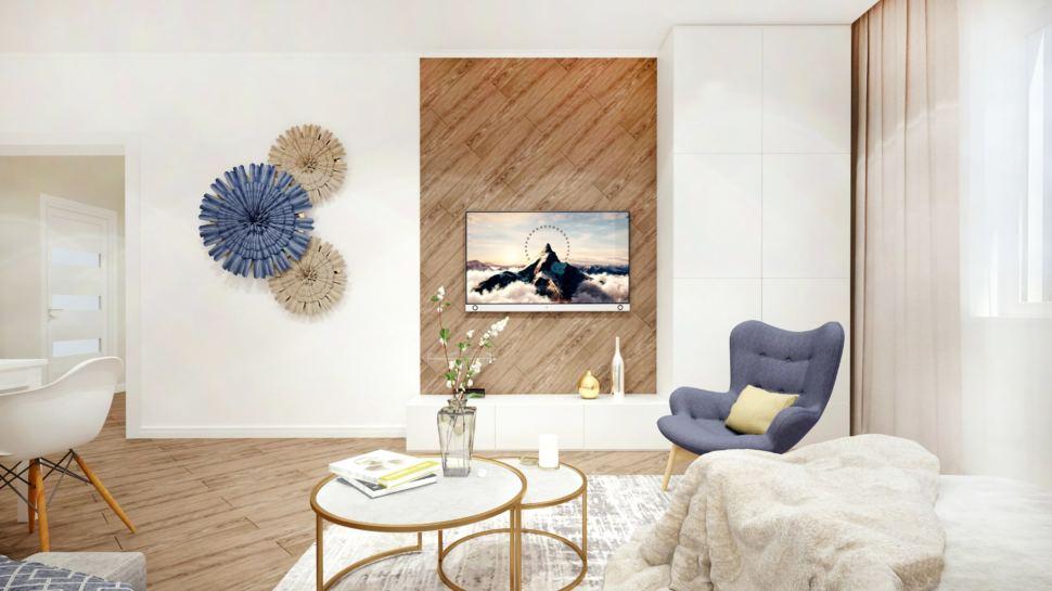 Гостиная 40 кв.м в светло - бежевых тонах, синее кресло, декор, журнальный столик, телевизор, пвх плитка