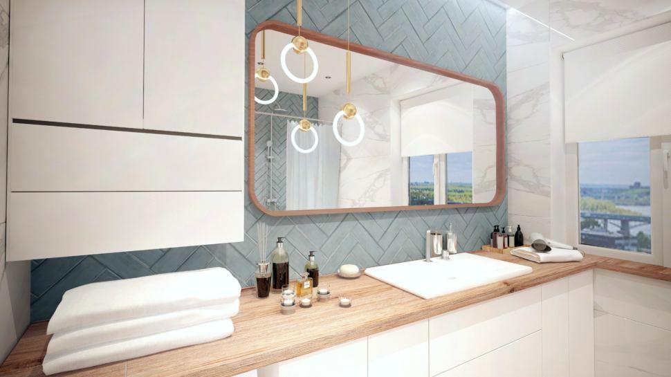 Интерьер ванной комнаты, зеркало, раковина, белый шкаф, подвесные светильники, керамическая плитка сложного синего цвета