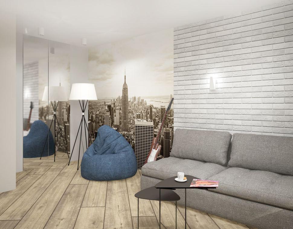 Дизайн интерьера гостиной в серых тонах с синими акцентами 18 кв.м, синие кресло-мешок, белая напольная лампа, серый диван