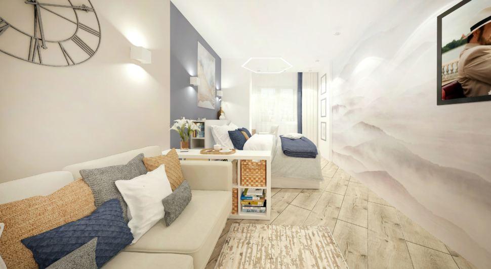 Дизайн интерьера гостиной-спальни в белых тонах с синими оттенками 15 кв.м, бежевый диван, белая тумба, часы, кровать