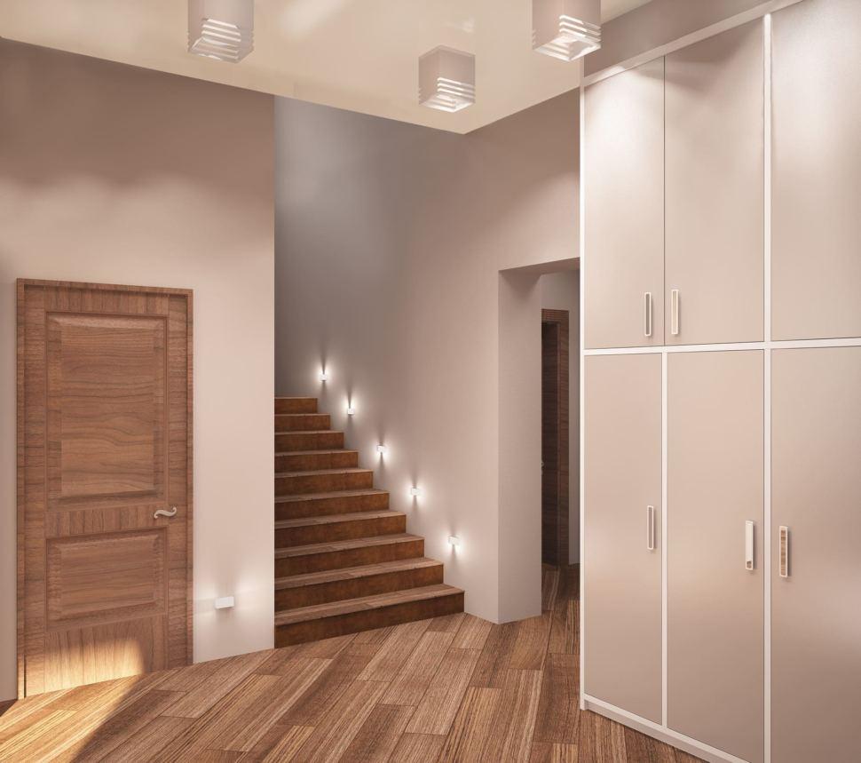 Дизайн интерьера коридора 16 кв.м в коттедже с пастельными бежевыми тонами, белый шкаф, лестница, паркет,зеркало, светильники