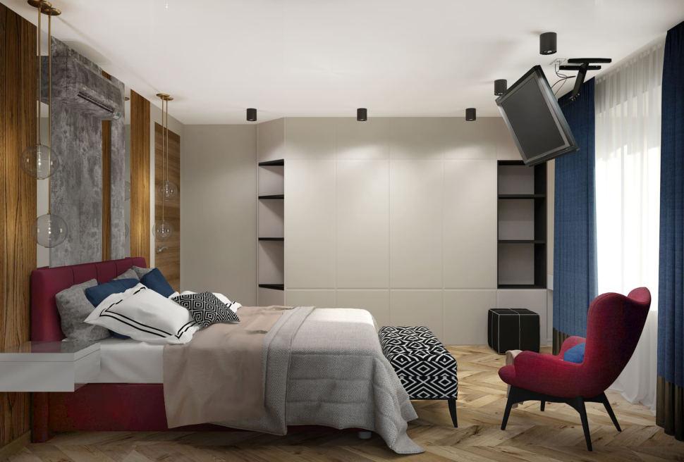 Дизайн спальни в синих и бордовых тонах 16 кв.м, бордовое кресло, бордовая кровать, белый шкаф