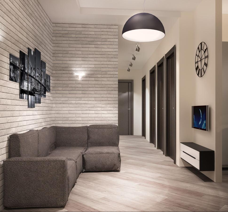 Интерьер кухни- гостиной 16 кв.м в светлых тонах с акцентами, серый диван, декоративные обои, подвесная тумба, телевизор, декор