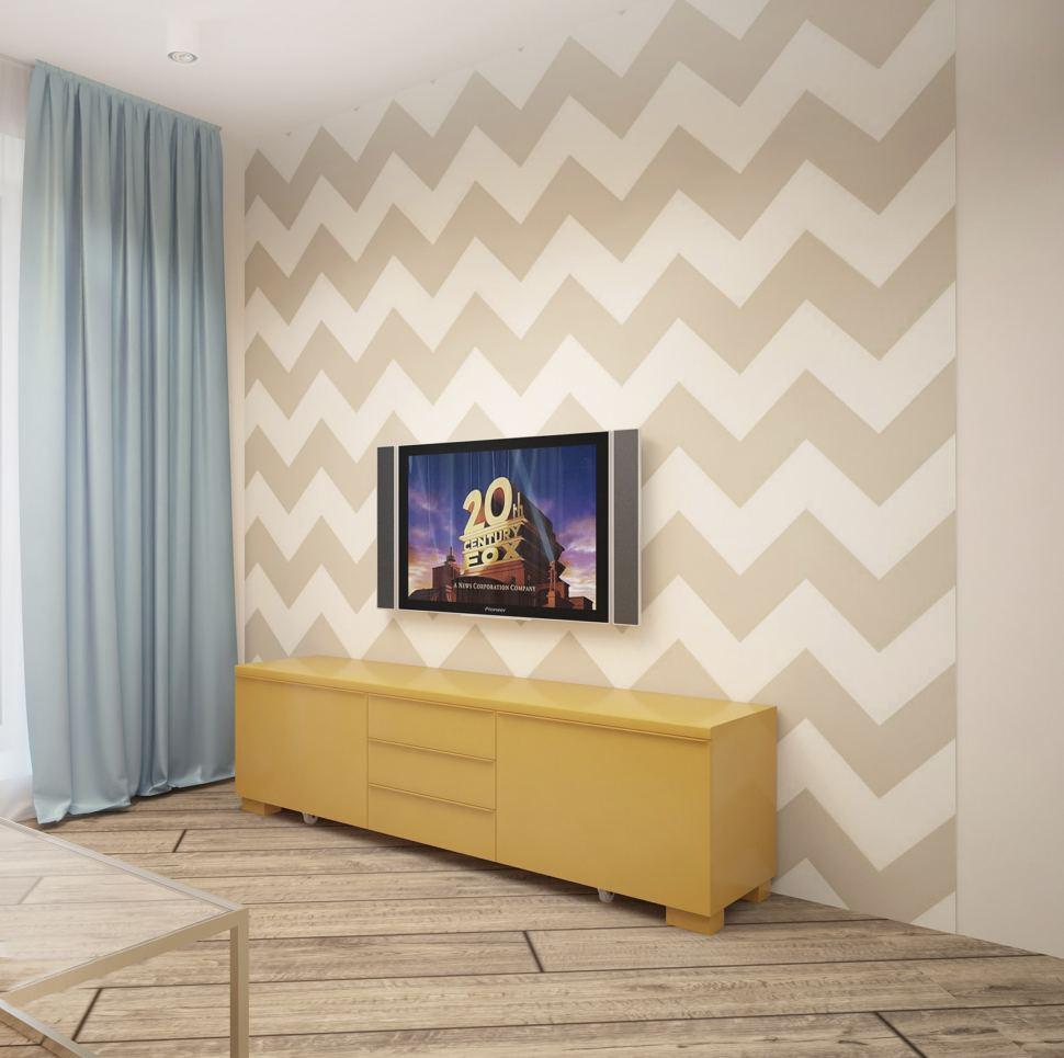 Интерьер кухни-гостиной 20 кв.м в теплых оттенках, голубые портьеры, декоративные обои, желтая тумба под ТВ, телевизор, светильники