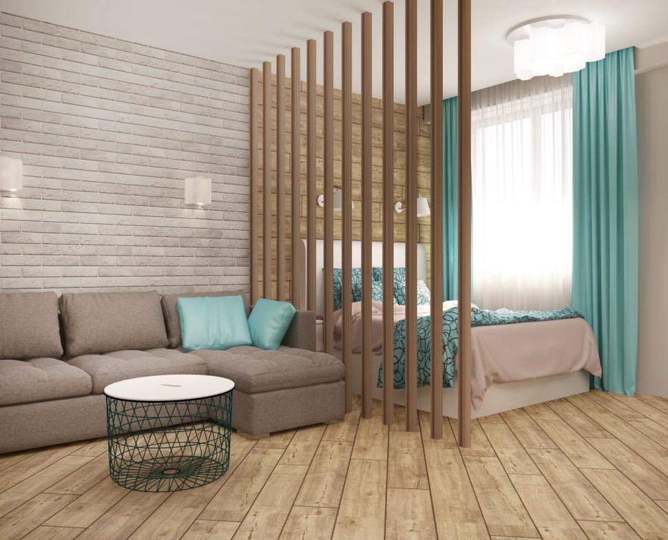 Интерьер спальни-гостиной 22 кв.м в песочных тонах с бирюзовыми оттенками, серый диван, бра, декоративная перегородка из брусков, журнальный столик, светильники