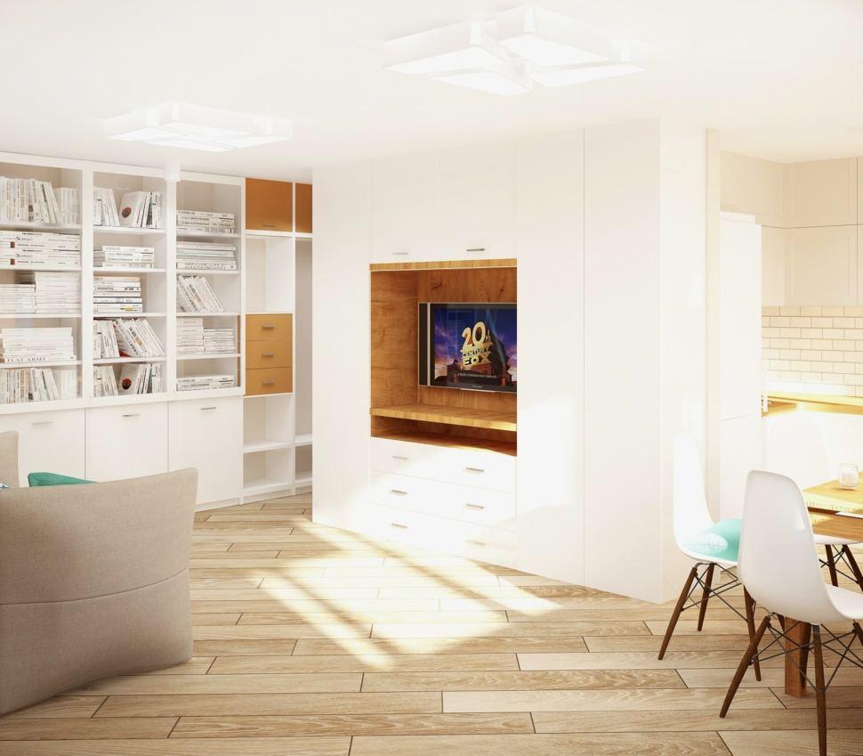 Интерьер кухни-гостиной 23 кв.м в бежевых тонах с бирюзовыми акцентами, обеденные стулья, белый шкаф, телевизор, открытые полки, серый диван