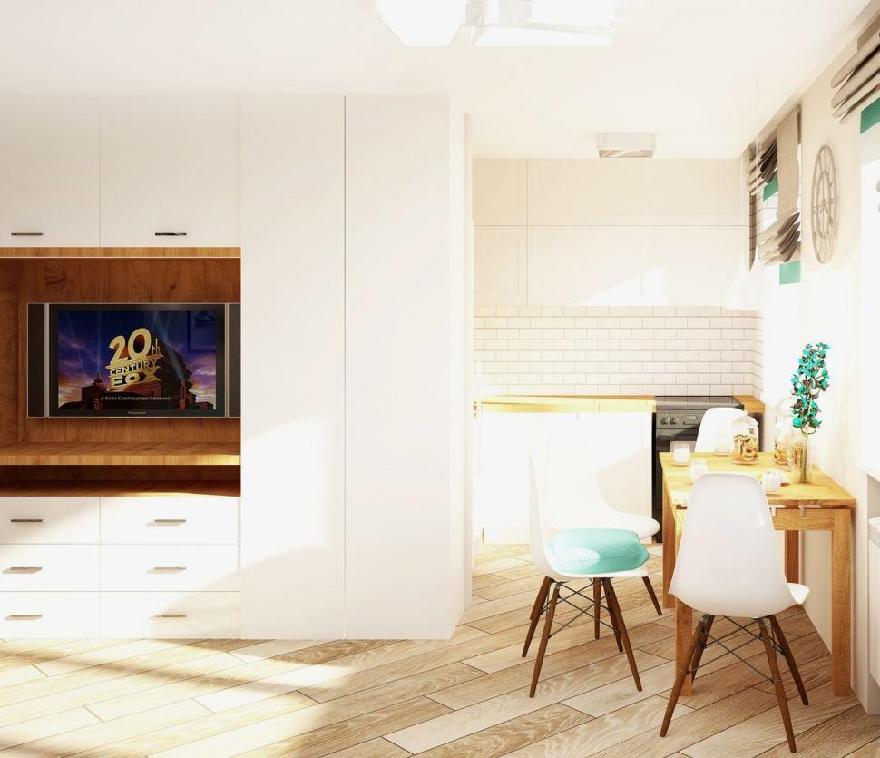 Интерьер кухни-гостиной 23 кв.м в светлых тонах с бирюзовыми акцентами, телевизор, система хранения, стеллаж, шкаф, диван