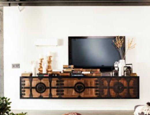 Фото 39 - Интересная дизайнерская тумба под ТВ играет роль не только функциональной мебели, но и отличным элементом декора [14]