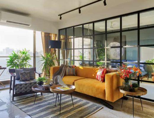 Фото 63 - Яркий дизайн гостиной был создан за счет использования теплых оттенков и красных акцентов [23]